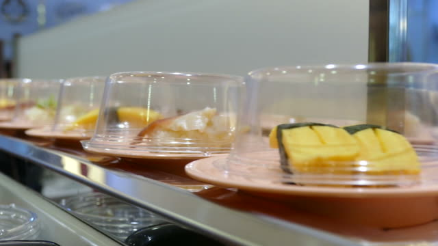 sushi on serving line video