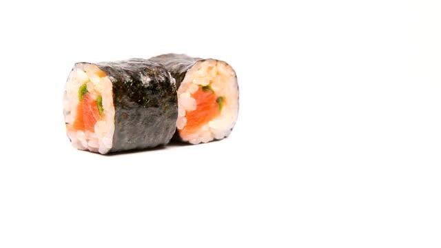 sushi rolls rotating on white presentation video