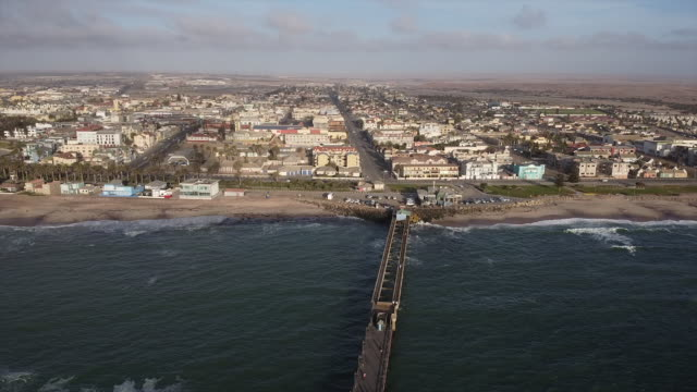 Swakopmund. From Jetty to Town A slow flight from the jetty towards the town in the back ground on a sunny day afternoon. Swakopmund. Namibia. Skeleton Coast. swakopmund stock videos & royalty-free footage