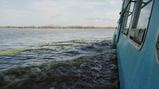 A Swamp Boat Sails Across the Atchafalaya River Basin Swamp in Southern Louisiana