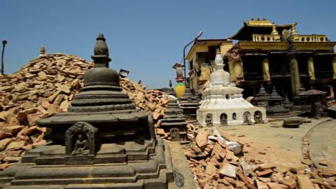 KATHMANDU, NEPAL - MAY 1, 2015: Swayambhunath (monkey temple) stupawhich was severly damaged after the major earthquake KATHMANDU, NEPAL - MAY 1, 2015: Swayambhunath (monkey temple) stupawhich was severly damaged after the major earthquake on 25 April 2015. 2015 stock videos & royalty-free footage