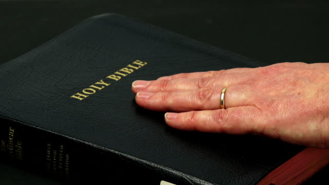 Swearing On The Bible Close-up (4:2:2@100 Mb/s) video