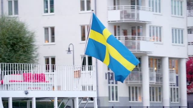 A Swedish flag on the back of the ship cruising in Stockholm Sweden video
