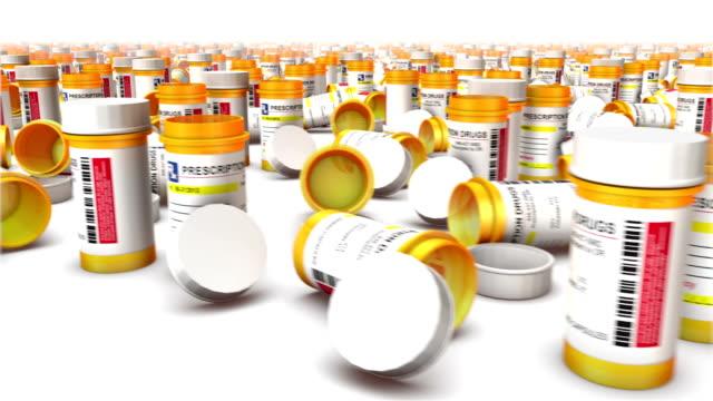 sweeping across endless empty pill bottles front - amfetamin pills bildbanksvideor och videomaterial från bakom kulisserna