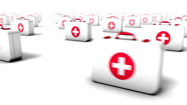 Sweeping across endless First Aid Kits front Camera sweeping past the fronts of endless rows of First Aid Kits extending in a grid pattern to the horizon medevac stock videos & royalty-free footage