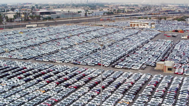 Sweeping Drone Shot of New Car Yard on Dock video