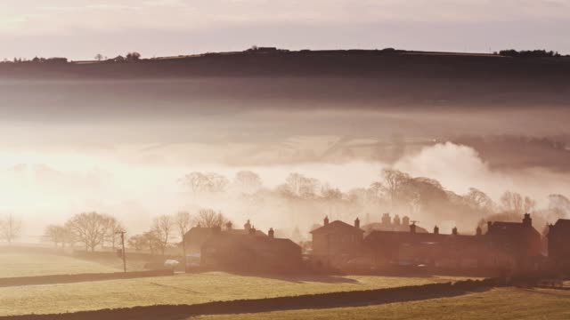 Sweeping Drone Shot of Oxenhope, W Yorkshire Covered in Morning Fog video