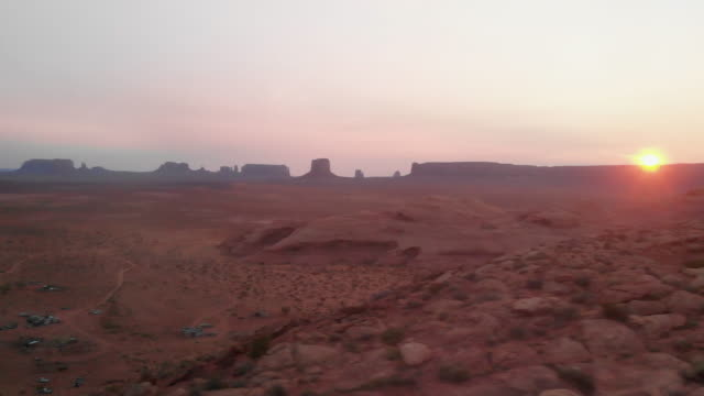 Sweeping Drone Shot of the Vast Navajo Indian Reservation near Monument Valley Tribal Park in Northern Arizona at Dusk or Dawn in the Summer Time