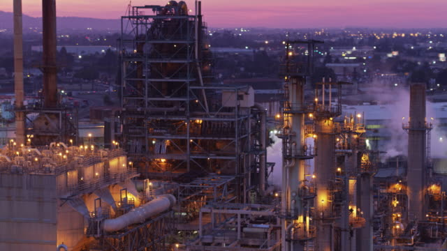 Sweeping Drone Shot Over Oil Refineries at Sunset - video