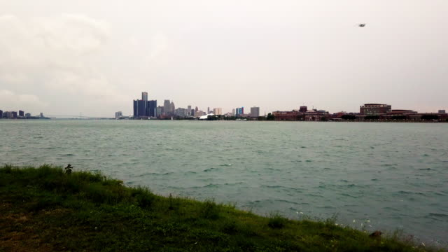 A Sweeping Drone View Of The Detroit City Skyline From Belle Isle On A Cloudy Afternoon