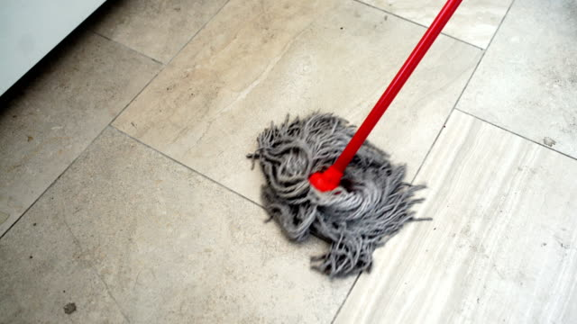 sweeping the floor with a mop. - stay at home parent stock videos & royalty-free footage