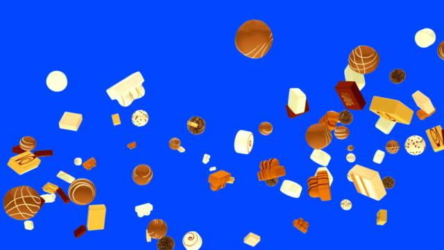 ブルースクリーンに対してスローモーションで飛んでいる甘いボンボン - バレンタイン チョコ点の映像素材/bロール