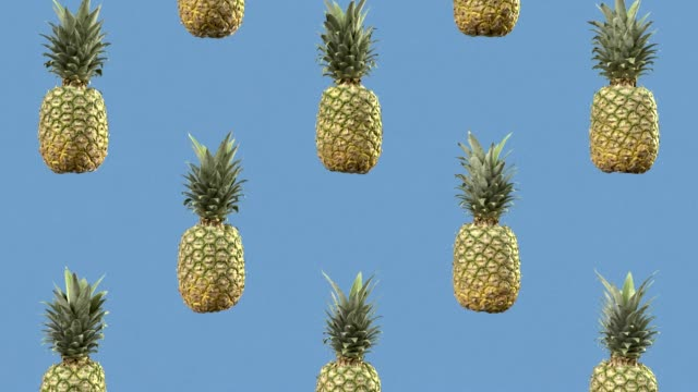 sweet pineapples are slowly falling. looped animation. motion background - healthy green juice video stock e b–roll