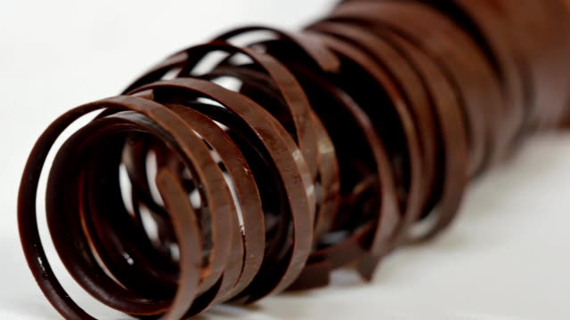 sweet tubes - dessert. chocolate tube for decoration, closeup - delis stock videos and b-roll footage