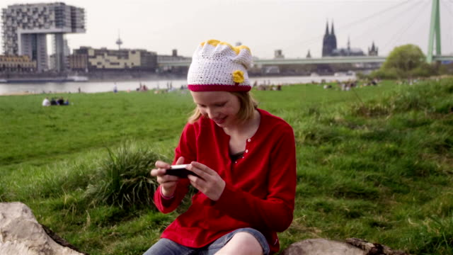 Sweet, Young Teenage Girl, smiling, beanie, taking Selfies outdoors video