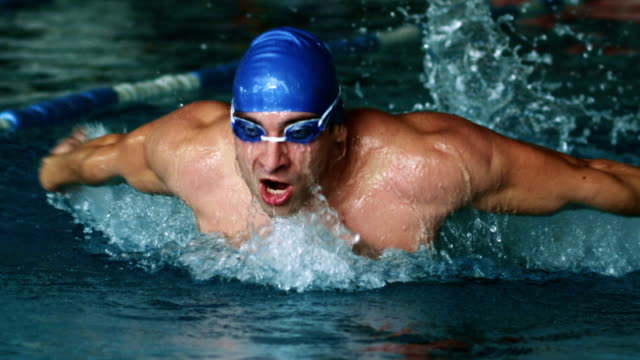 Swimmer doing the butterfly stroke video