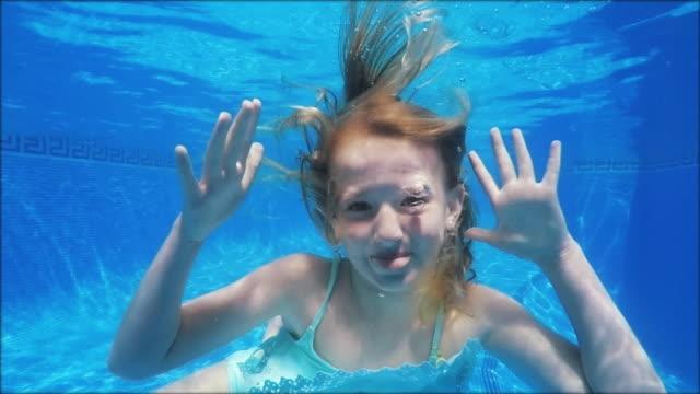 Swimming funny girl making fun - in slowmotion - video
