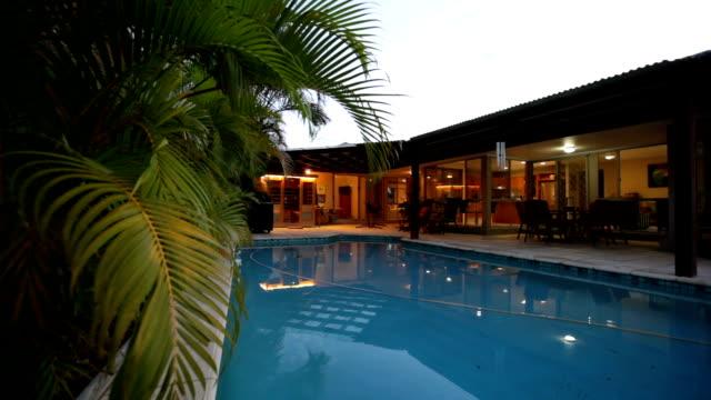 stockvideo's en b-roll-footage met zwembad in de schemering - garden house