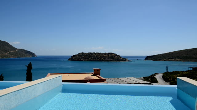Swimming pool at luxury villa with view on Spinalonga island video