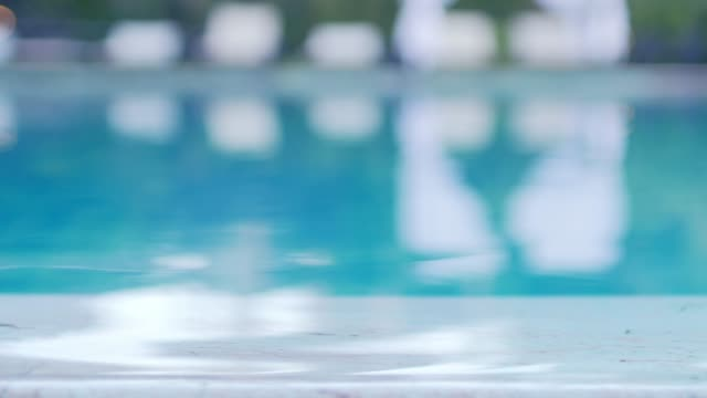 swimming pool blurred for footage background - superficie dell'acqua video stock e b–roll