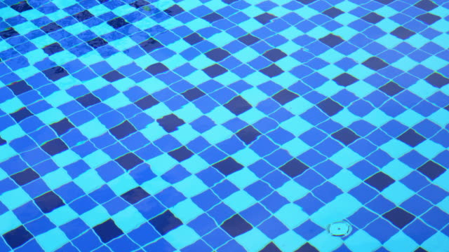 Swimming pool surface with floor mosaic tile