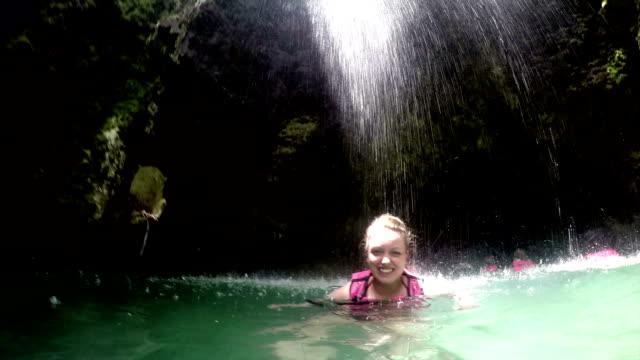 Swimming through Waterfall video