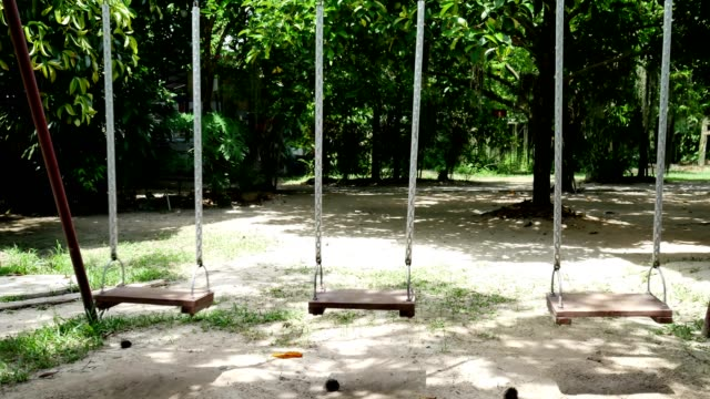 Swing chairs ultra hd. Swing chairs in park slide shot. rocking chair stock videos & royalty-free footage