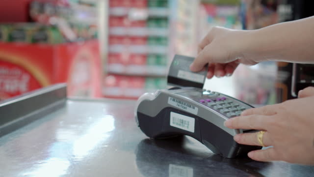 Swiping A Credit Card at supermarket checkout,Close-up Swiping A Credit Card at supermarket checkout,Close-up credit card purchase stock videos & royalty-free footage