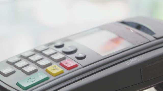 Swiping A Credit Card,Close-up video
