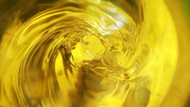 swirl of tea in a glass in 4k slow motion 60fps - spirale ricciolo video stock e b–roll