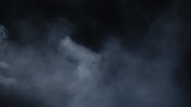 Swirling atmospheric environment smoke Atmospheric smoke overlay. Haze background. Abstract smoke cloud. Smoke in slow motion on black background. White smoke slowly floating through space against black background. Mist effect. Fog effect. VFX Element. steam stock videos & royalty-free footage