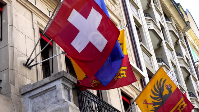Swiss and Geneva flags hang on the building. video