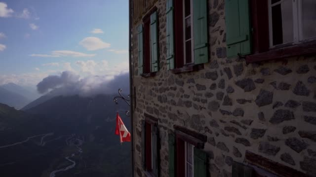 Swiss flag flutters on building in the wind