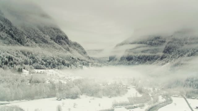 Swiss Valley In Mist and Snow - Drone Shot video