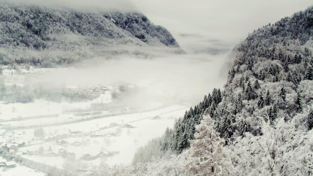 Swiss Village Hidden Under Mist and Snow - Drone Shot video