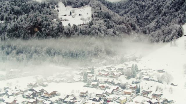 Swiss Village in Snowy Alpine Valley - Drone Shot video