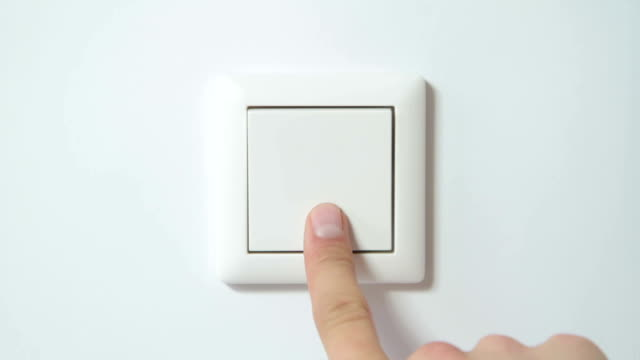 Switch on a White Wall - Close-Up from Front Different shots of a white light-switch on a white wall being switched on and off combined in one file. Directly from front, close-up. Hand coming in from different angles each time. start button stock videos & royalty-free footage