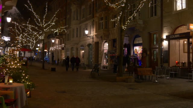 switzerland night time illuminated zurich old town walking street panorama 4k video