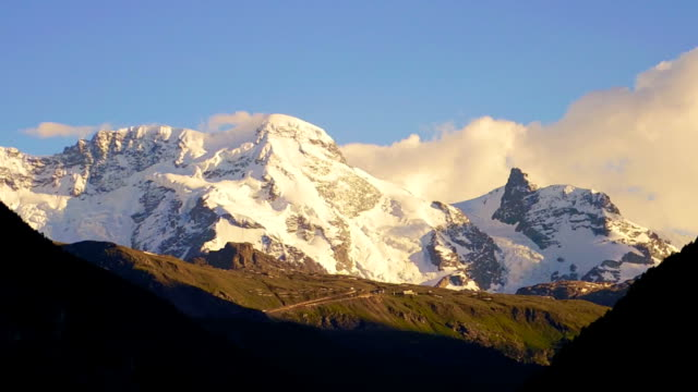 stockvideo's en b-roll-footage met switzerland snow mountain at sunset - wallis