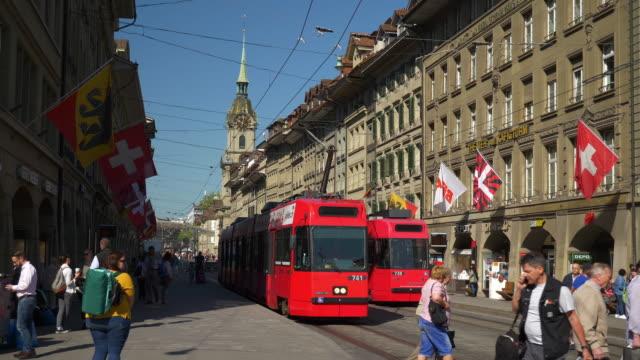 switzerland sunny day bern city tram traffic main street panorama 4k - tranvia video stock e b–roll