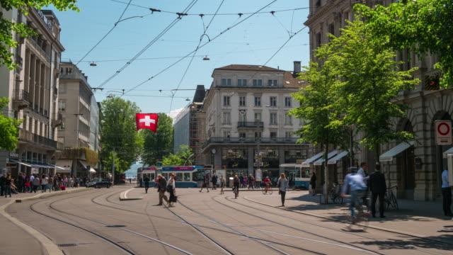 switzerland sunny day zurich city traffic bahnhofstrasse panorama 4k timelapse - szwajcaria filmów i materiałów b-roll
