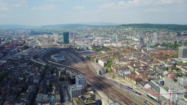 switzerland zurich cityscape office buildings construction railroads aerial panorama 4k - google filmów i materiałów b-roll