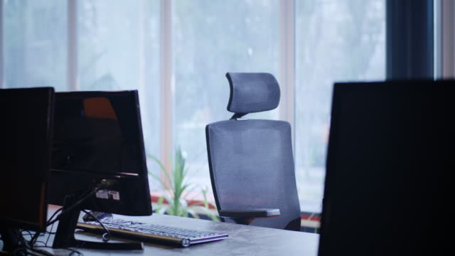 Swivel chair in an office Medium shot of a swivel chair in an office chair stock videos & royalty-free footage