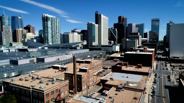 swooping around Denver , Colorado , USA Skyline Cityscape Downtown urban development in the Mile High City