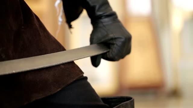 Sword in Mens Hands video