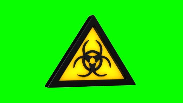 stockvideo's en b-roll-footage met symboolbiohazard op groene achtergrond. geïsoleerde 3d-render - waarschuwingssignaal