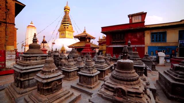 symbol of nepal, buddha's eyes in kathmandu. - stupa stok videoları ve detay görüntü çekimi