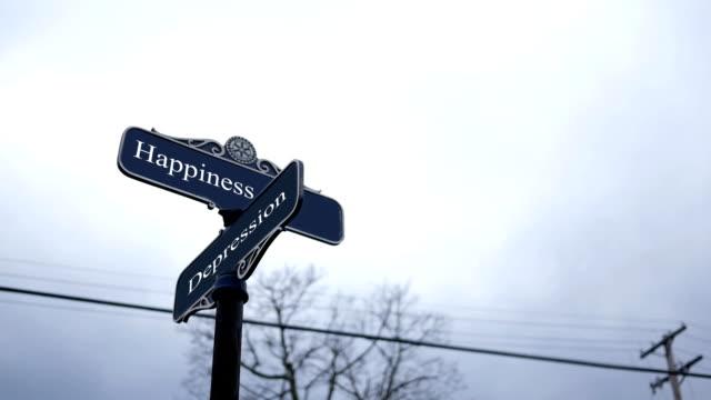 symboliska crossroads typografi med dark sky - lycka och depression - illavarslande bildbanksvideor och videomaterial från bakom kulisserna