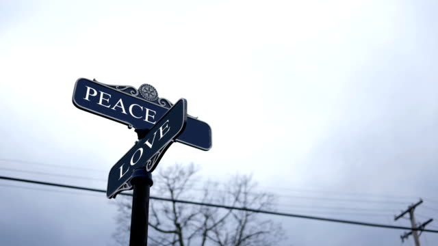 Symbolic crossroads typography with dark sky -  Peace and Love video