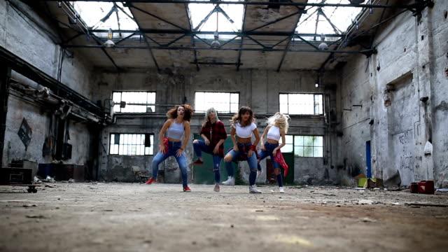 Synchronized break dancers performing together